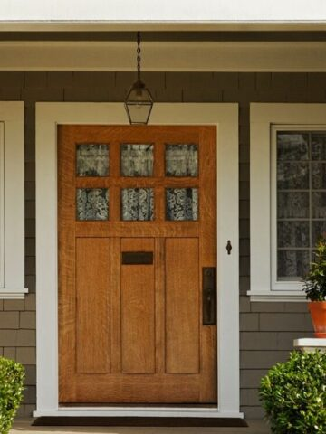 front door with pillars on a sustainable home