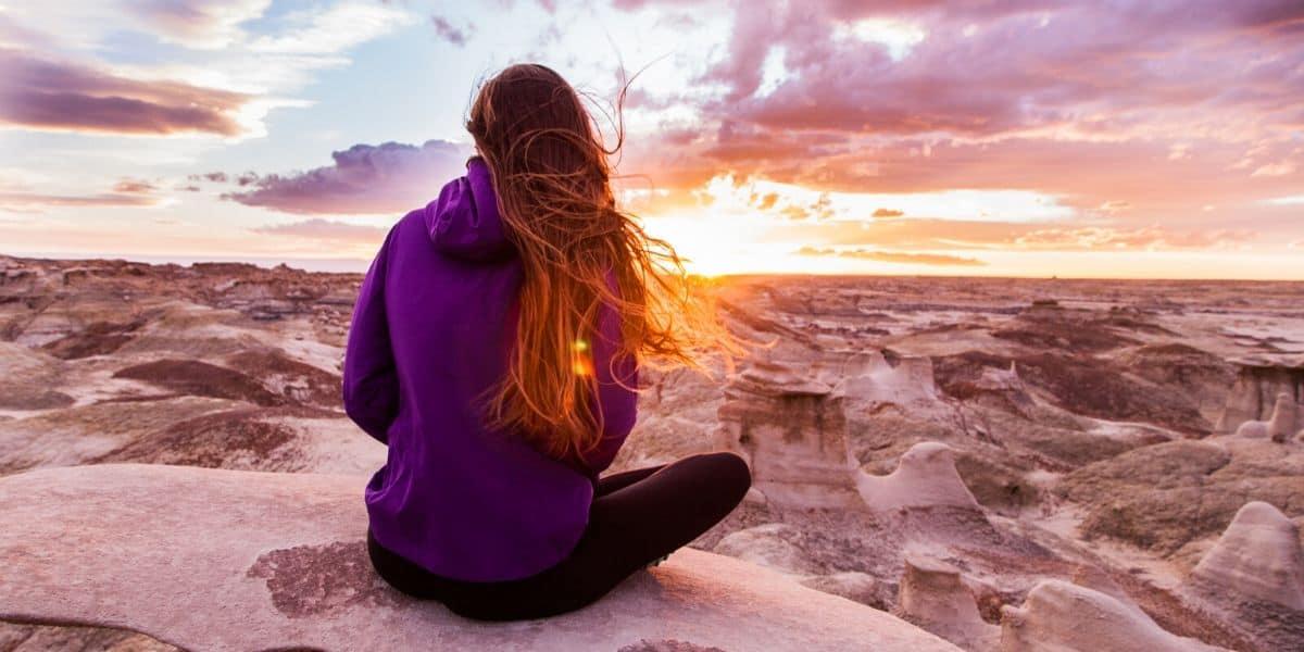 woman overlooking sunset wearing circular fashion