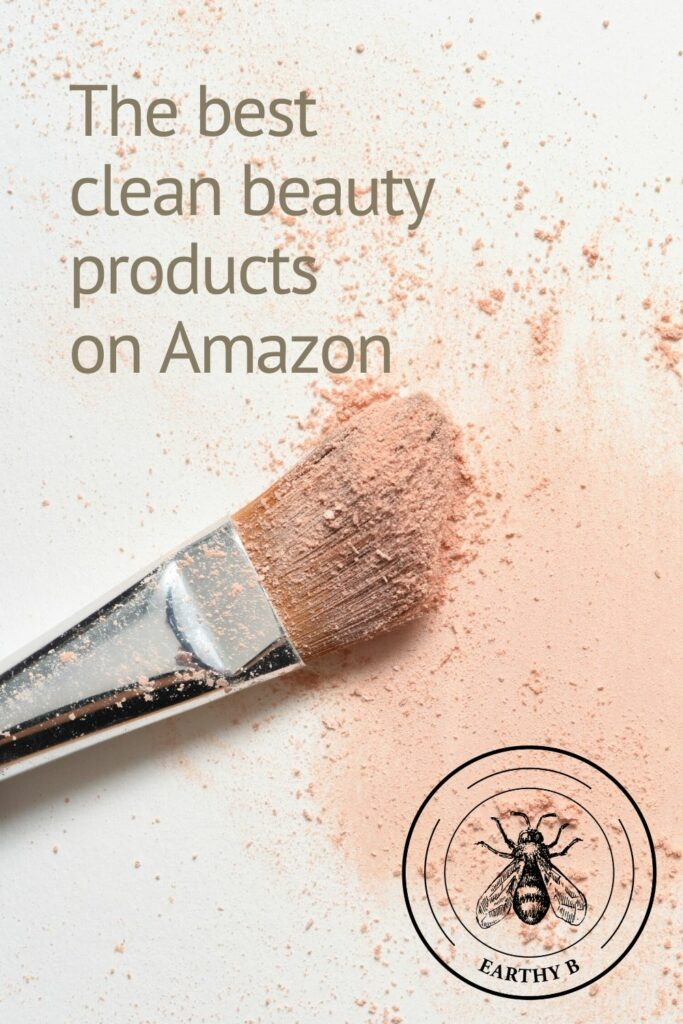Clean make-up brush with light pink powder blush smeared on white background with text overlay that reads The best clean beauty products on Amazon.