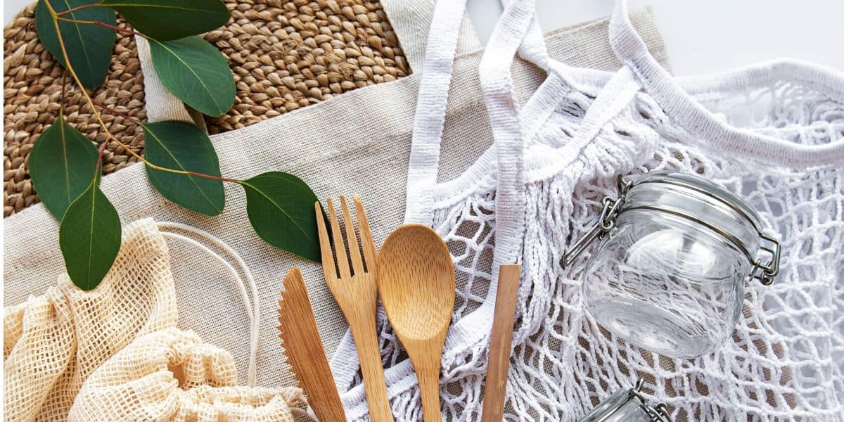 Sustainable products like reusable spoon, fork and knife with reusable bag and glass container