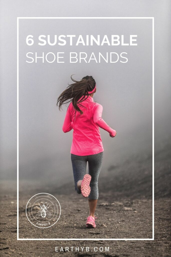 Woman wearing pink running on trail wearing sustainable shoes.