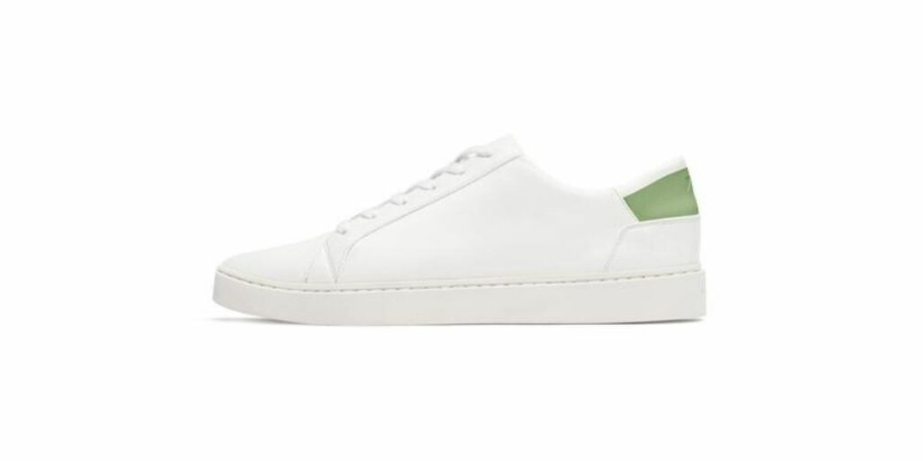 White lace up sneakers by circular fashion brand ThousandFell.