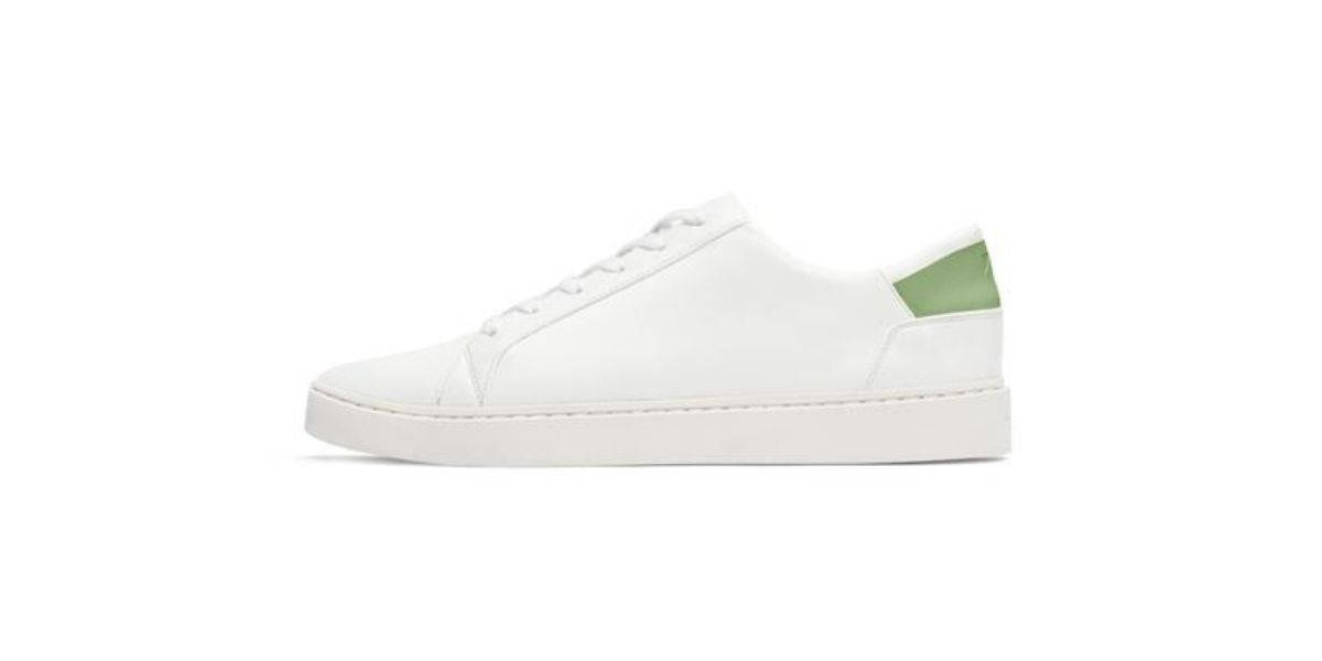 White lace up sneakers by circular economy shoe brand Thousand Fell.