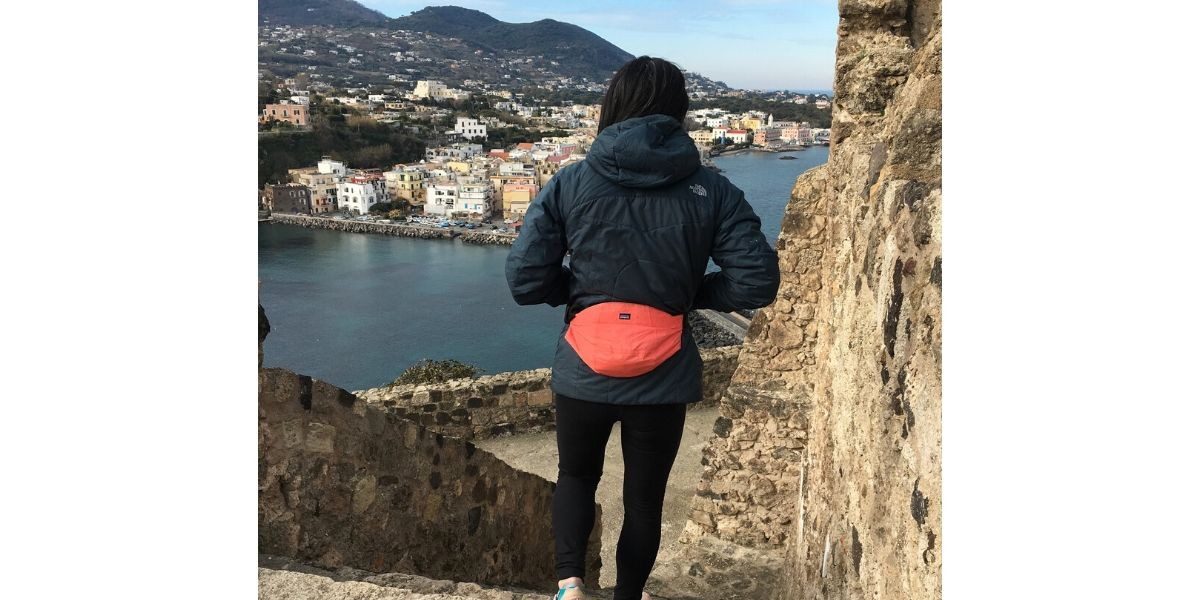Woman wearing fanny pack made from recycled jacket hoods.