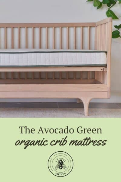 Pin with Avocado Green organic crib mattress in a crib
