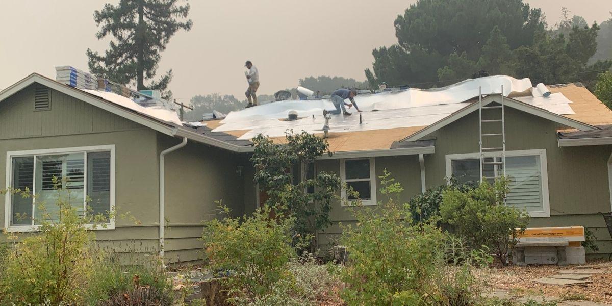 Men installing cool roof