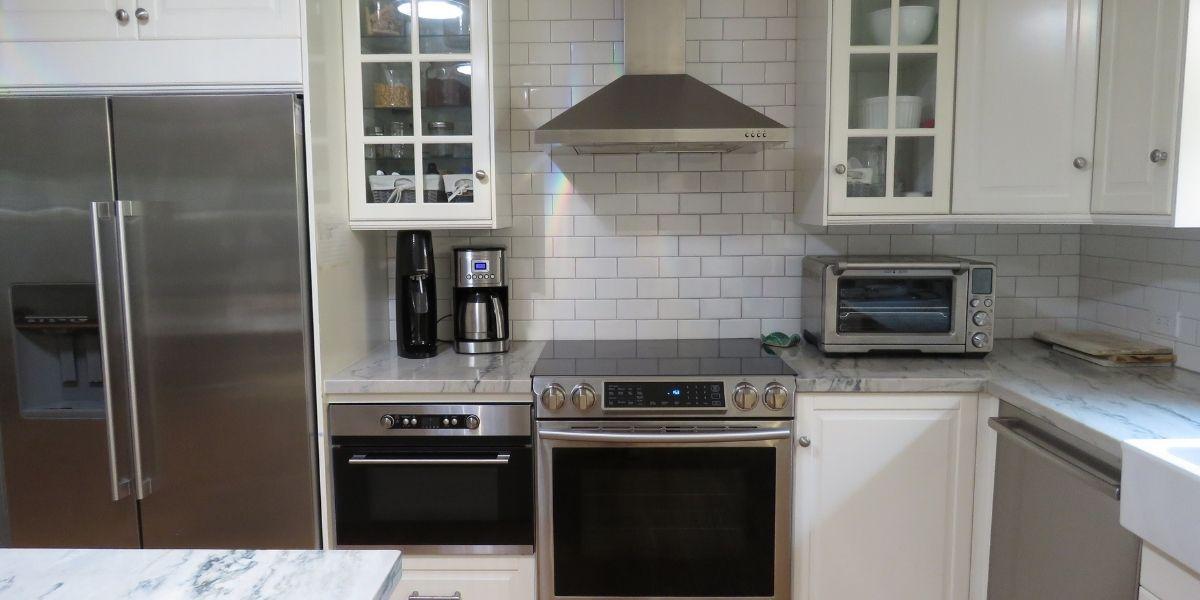 Induction range in white kitchen