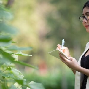 Sustainable business consultant taking inventory in nature