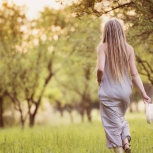 woman in nature thinking about sustainable online shopping