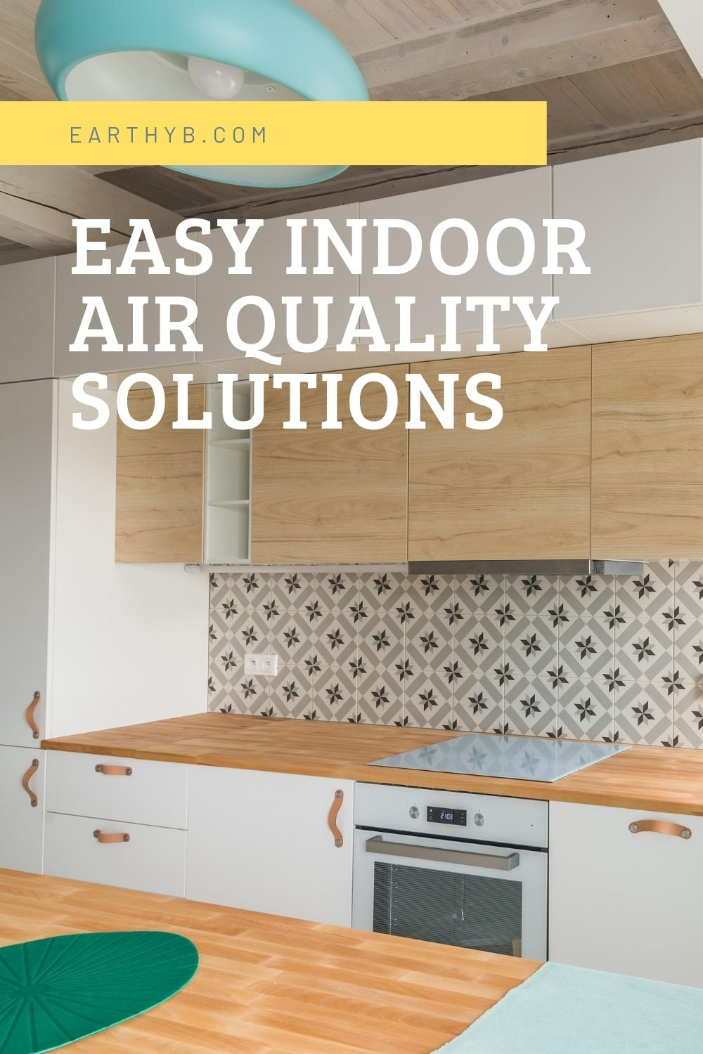 """Kitchen with electric cooktop and hood vent inside a kitchen cabinet with text overlay that reads """"Easy Indoor Air Quality Solutions"""""""