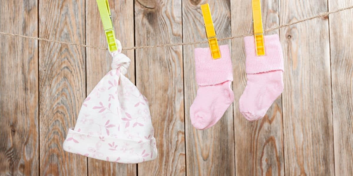 rented baby clothes hanging on a line