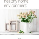 "Pinterest pin with image of tea roses and empty frames with text that reads ""How to create a healthy home environment"""