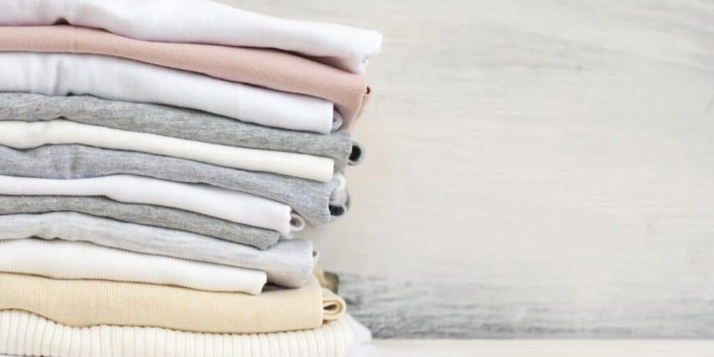 Stack of sustainably-made t-shirts