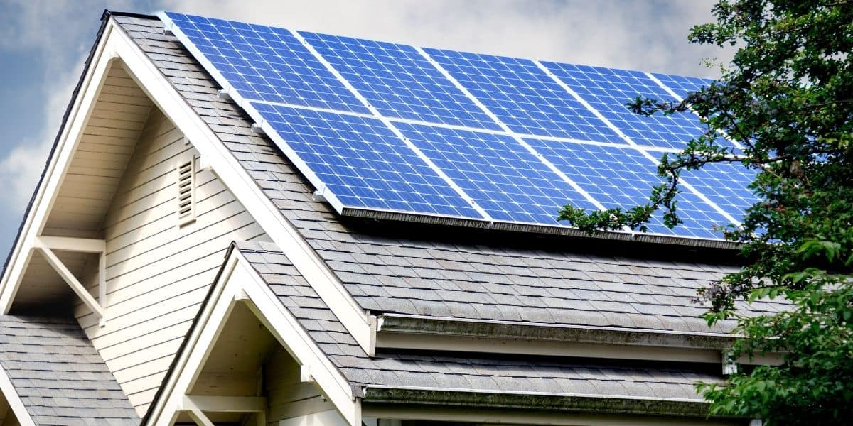 Gray composite roof with blue solar panels
