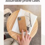 Hand touching phone case made from cork tree bark on table