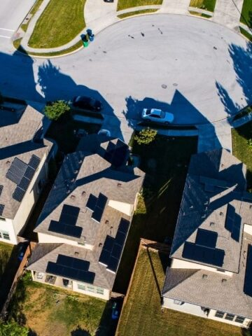 Single family residential neighborhood with solar panels on the roof