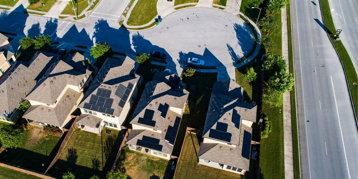 Neighborhood with multiple single family homes with solar panels on the roof