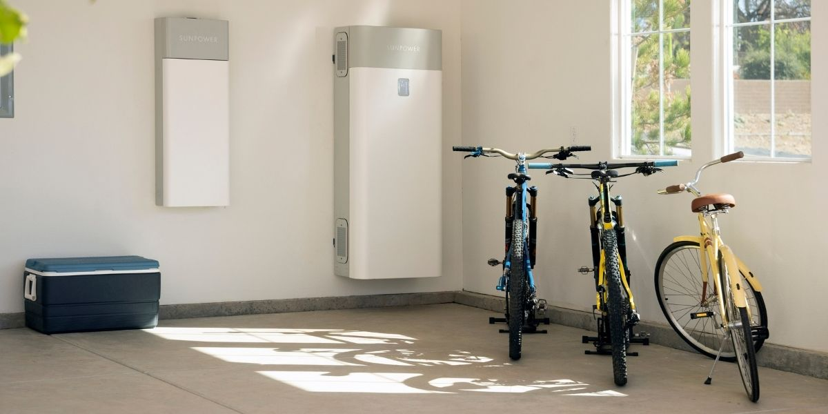 SunPower SolarVault residential solar energy storage in garage next to bicycles in Woodside, California.